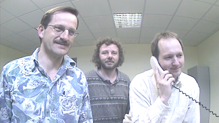 Three Botec developer, one of them is on the phone