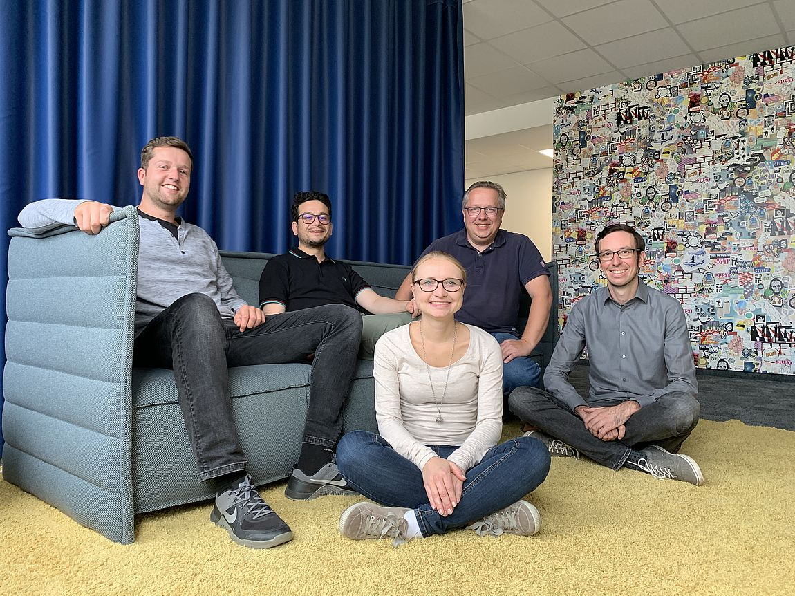 Group photos of five people on the couch