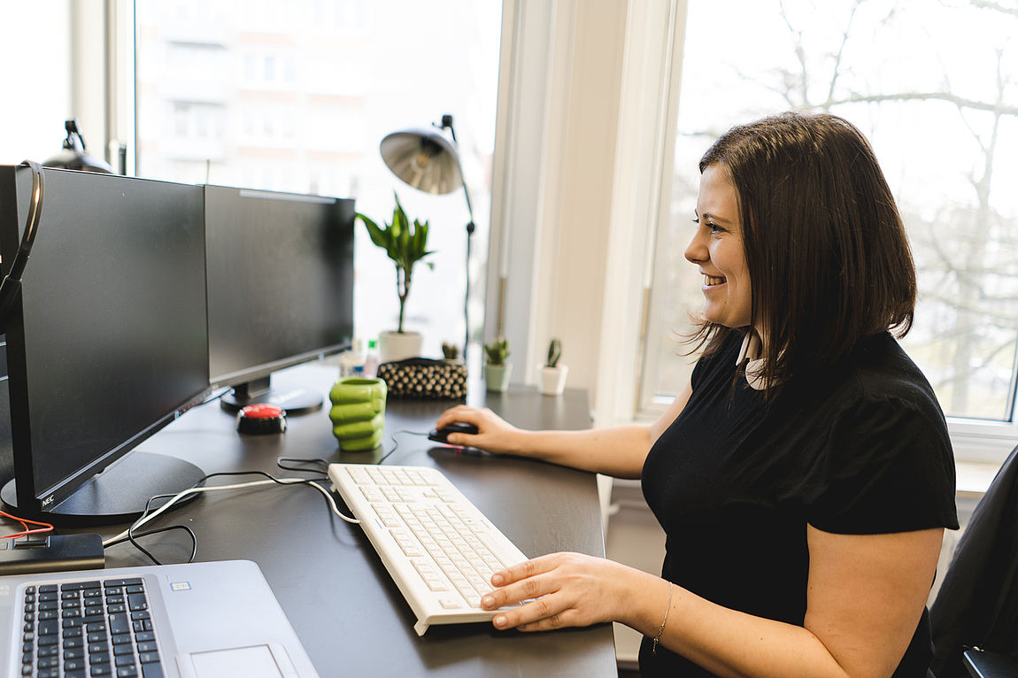 Woman in front of standing desk in the office